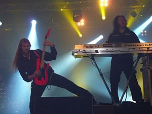 Tuomas Seppälä - Seppälä to the right and Emil Pohjalainen to the left, on tour with Amberian Dawn in 2009.