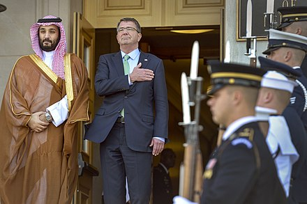 Crown Prince and Defence Minister Mohammad with U.S. Secretary of Defense Ashton Carter, Pentagon, 13 May 2015 U.S.Defense Secretary Ash Carter places his hand over his heart as the national anthem plays during an honor cordon to welcome Saudi Defense Minister Mohammed bin Salman Al Saud to the Pentagon, May 13, 2015 150513-D-NI589-527c.jpg