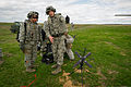 U.S. Air Force Airman 1st Class Cameron Alexander, right, a radio frequency transmission specialist with the 375th Aeromedical Evacuation Squadron (AES), Scott Air Force Base, Ill., and Lt. Col. Monsita Faley 140314-F-XL333-217.jpg