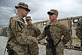 U.S. Army Command Sgt. Maj. Christopher Menton, left, with the 4th Brigade Combat Team, 1st Cavalry Division, presents a coin to a Soldier assigned to the 249th Engineer Battalion at Bagram Airfield, Parwan 130510-A-XM609-010.jpg