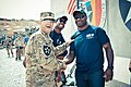 U.S. Army Sgt. Maj. Daniel Adle, left, the operations sergeant major of the 4th Brigade Combat Team, 2nd Infantry Division, shares a light moment with Cleveland Browns linebacker D'Qwell Jackson, right, during 130318-A-DE841-7760.jpg