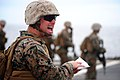 U.S. Marine Corps Cpl. Clay O'Dell, assigned to Fleet Anti-Terrorism Security Team Pacific (FASTPAC), shouts out instructions during an advanced driven combat drill May 30, 2013, aboard the U.S. 7th Fleet 130530-N-QI421-286.jpg