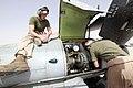 U.S. Marine Corps Cpl. Randall H. Borgman, left, a crew chief, and Lance Cpl. Robert J. Powell, an aircraft mechanic, both with Marine Medium Tiltrotor Squadron (VMM) 165, conduct rotor track and balance 130816-M-BU728-099.jpg
