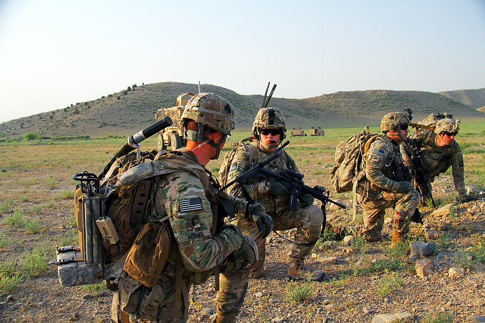 U.S. Soldiers with Echo Company, 2nd Battalion, 506th Infantry Regiment, 4th Brigade Combat Team, 101st Airborne Division kneel June 2, 2013, before a mission in Khost province, Afghanistan 130602-A-DQ133-039
