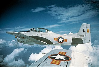 1st Special Operations Wing - 4400th CCTS North American T-28A-NA Trojan Serial, AF Ser. No. 51-3579, wearing Republic of Vietnam Air Force markings flies over Vietnam