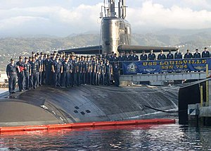 USS Louisville (SSN-724) - The crew of the Los Angeles class submarine USS Louisville (SSN-724) pose for a picture with their submarine.