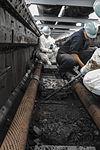 USS Ronald Reagan sailors clean catapult trench 140904-N-AC737-026.jpg