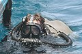 US Navy 030619-N-5362A-003 Hull Technician 2nd Class Arron Edmonds, assigned to Explosive Ordnance Disposal Mobile Unit Six (EODMU-6), conducts a diving operation.jpg