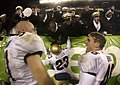 US Navy 031206-N-9693M-502 Navy linebacker Bobby McClarin, left, congratulates fullback Ryan Barry, right, as defensive back Vaugn Kelly shares a celebratory moment with Midshipmen following the 104th Army Navy Game.jpg