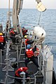 US Navy 040218-N-0000W-001 Deck personnel aboard the mine countermeasure ship USS Guardian (MCM 5) recover gear after completing a mine sweep.jpg