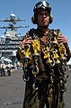 US Navy 040416-N-9851B-001 Aviation Machinist Mate Airman James Carney carries tie-down chains to his aircraft.jpg