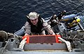 US Navy 040423-N-5319A-014 Hospital Corpsman 3rd Class Adam D. Snook, from Bellingham, Wash., climbs a pilot's ladder as the Visit Board Search and Seizure team (VBSS) assigned to USS Bulkeley (DDG 84).jpg