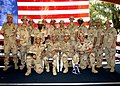 US Navy 040711-N-1126D-001 Sixteen Seabees from Naval Mobile Construction Battalion Fourteen were presented with Purple Heart Medals for injuries sustained on April 30, 2004, while deployed in support of Operation Iraqi Freedom.jpg
