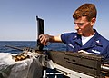 US Navy 040729-N-4374S-001 Mineman 3rd Class Mike Sturgeon assigned to the mine countermeasure ship USS Dextrous (MCM 13) performs daily planned maintenance on a .50 caliber machine gun.jpg