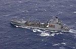 US Navy 040823-N-0120R-051 The Military Sealift Command (MSC) ŝmiristo USNS Jukonio (T-A0 202) prepariĝas por kompletigo-ĉe-maro (RAS) kun USS Kitty Hawk (CV 63) en turbula okcidenta Pacific Ocean.jpg