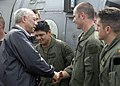 """US Navy 050105-N-5376G-016 Secretary of State Colin Powell greets U.S. Navy air crewmen assigned to the """"Golden Falcons"""" of Helicopter Anti-Submarine Squadron Two (HS-2) on the runway at Sultan Iskandar Muda Airport.jpg"""