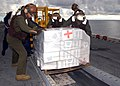 US Navy 050106-N-9214D-141 Marines assigned to the Combat Cargo division aboard the amphibious assault ship USS Bonhomme Richard (LHD 6), load medical relief supplies into a Marine CH-46E Sea Knight helicopter.jpg