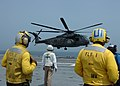 US Navy 050607-N-2258R-003 Flight deck personnel aboard the Nimitz-class aircraft carrier USS Dwight D. Eisenhower's (CVN 69) look on as an MH-53E Sea Dragon helicopter lands on the flight deck.jpg