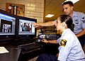 US Navy 050713-N-0892E-002 Seaman Elizabeth Evans, foreground, receives instruction from Photographer's Mate 1st Class Martin Geil on basic digital photograph editing techniques.jpg