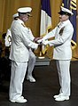 US Navy 050722-N-0295M-013 Master Chief Petty Officer of the Navy (MCPON) Terry Scott presents Adm. Vern Clark's retired Chief of Naval Operations flag.jpg