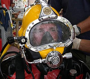 Diving helmet - Image: US Navy 051026 N 0000X 001 Electronics Technician 1st Class Matthew Ammons, a diver assigned to Mobile Diving and Salvage Unit Two (MDSU 2), is fitted with a Kirby Morgan 37 Dive Helmet