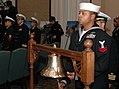 US Navy 060113-N-8907D-014 Boatswain's Mate 2nd Class Eric Kenith prepares to strike ceremonial bells during the arrival of the official party during the establishment ceremony for the Navy Expeditionary Combat Command he.jpg