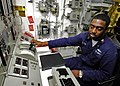 US Navy 060411-N-7981E-003 Gas Turbine Systems Technician 2nd Class Rondell Bethelmy makes speed adjustments from the propulsion plant auxiliary control console.jpg