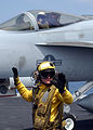 US Navy 060423-N-6484E-003 On the flight deck of the Nimitz-class aircraft carrier USS Theodore Roosevelt (CVN 71), Aviation Boatswain's Mate Handler 3rd Class Jeremy Sills looks for oncoming aircraft.jpg