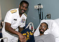 US Navy 060426-N-7517M-009 Vice Director for Operations for the Joint-Staff, Rear Adm. Anthony Winns, gives a Navy T-shirt to a youth at the Children's Hospital of Atlanta.jpg