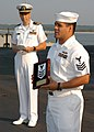 US Navy 060630-N-6651N-001 Mass Communication Specialist (MC) 1st Class Arthur Delacruz, right, one of the first Sailors in the Navy to wear the new MC-rating badge, addresses members of the legacy ratings during the media rati.jpg