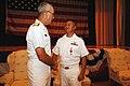 US Navy 060829-N-5758H-025 Director, Fleet Maintenance, Commander, U.S. Fleet Forces Command, Rear Adm. Jeffrey A. Brooks, presents the Bronze Star medal to Lt. Cmdr. Benito E. Baylosis.jpg