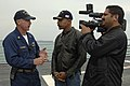 US Navy 061205-N-8148A-061 Montel Williams interviews Command Master Chief David Flannerry aboard guided-missile destroyer USS Howard (DDG 83).jpg