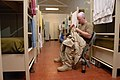 US Navy 070123-N-1722M-001 Electronics Technician 2nd Class Eric Youngstrom makes alterations to his newly issued desert camouflage uniform.jpg