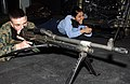 US Navy 070213-N-2143T-002 Pfc. Damon Vianueva and Master-at-Arms Seaman Alvethy Mendoza practice with a training machine gun in a Fire Arm Training Simulator (FATS).jpg