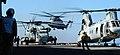 US Navy 070914-N-7643B-002 Navy and Marine Corps flight deck crewman await the landing of a CH-53D Super Stallion helicopter on board amphibious assault ship USS Tarawa (LHA 1).jpg