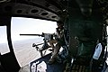 US Navy 071212-M-4213L-013 During flight, the crew chief, Sgt. J.R. Murphy, attached to Helicopter Light Attack Squadron (HMLA) 367, looks over the horizon with his .50-cal machine gun to scan for any enemy targets.jpg