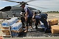 US Navy 080626-N-4009P-183 Bottles of water transported from the Nimitz-class aircraft carrier USS Ronald Reagan (CVN 76) are unloaded by Armed Forces of the Philippines (AFP), U.S. Navy personnel and civilians.jpg