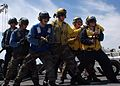 US Navy 080915-N-8132M-028 Sailors assigned to the starboard hose team simulate fighting fires.jpg