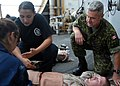 US Navy 080926-N-9134V-043 Canadian Army Capt. Rory MacDonald comforts a simulated victim.jpg
