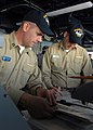US Navy 090213-N-5658B-016 Lt. Travis Dawson and Lt. James Thomas stand bridge watch.jpg