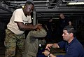 US Navy 090428-N-7948C-350 U.S. Coast Guard Boatswain's Mate 2nd Class Amaury Perez instructs a Gabonese sailor during an Africa Partnership Station visit, board, search and seizure workshop aboard the amphibious transport dock.jpg