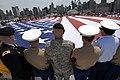 US Navy 090525-N-5033P-145 Members of the Fleet Week flag detail unfurl a U.S. flag during a Memorial Day commemoration aboard the USS Intrepid Sea, Air ^ Space Museum during Fleet Week New York City 2009.jpg