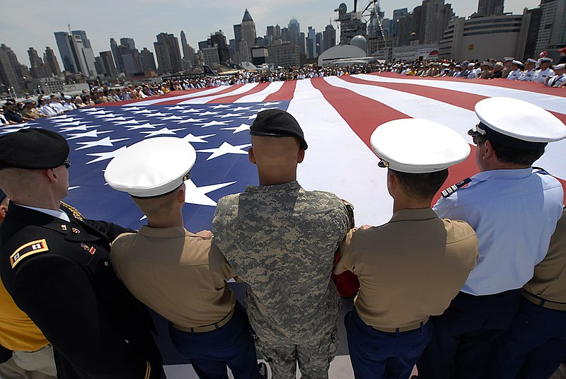 Giant US flag displayed aboard USS Intrepid, May 29, 2006