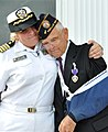 US Navy 090605-N-4134D-055 Former Aviation Metalsmith 1st Class Lewis Hopkins, a Battle of Midway survivor, is embraced.jpg