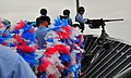 US Navy 090730-N-4774B-018 Sailors aboard the guided-missile cruiser USS Lake Champlain (CG 57) carry a large lei across the forecastle in preparation for the ship's homecoming.jpg