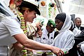 US Navy 091123-N-2420K-520 Capt. Alyson Caddell, strategic communication director for Combined Joint Task Force-Horn of Africa presents school supplies to a student at the Nioumamilima Primary School.jpg