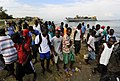 US Navy 100119-N-5345W-042 Haitian citizens watch as Sailors and Marines assigned to the Bataan Amphibious Relief Mission begin to come ashore to set up an operating base at the New Hope Mission at Bonel, Haiti.jpg