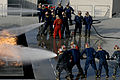 US Navy 100325-N-6552M-042 Sailors and Coast Guardsmen battle a simulated flight deck fire.jpg