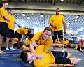 US Navy 100819-N-3852A-406 Operations Specialist Seaman Carol Chalut practices takedown defense moves with Gunner's Mate 3rd Class William Marler during Security Reaction Force Basic training.jpg
