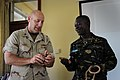 US Navy 110412-F-MN146-010 Petty Officer 1st Class Albert Perret, assigned to Combined Joint Task Force-Horn of Africa, demonstrates how to tie dif.jpg